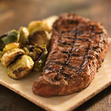 Grilled steak with brussel sprouts Royalty Free Stock Photos