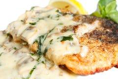 Grilled steak catfish under olive sauce Stock Image