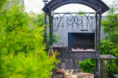 Grilled steak cooking on an open barbecue Stock Photo