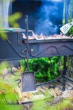 Grilled steak cooking on an open barbecue Stock Image