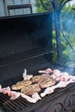 Grilled steak cooking on an open barbecue Stock Images