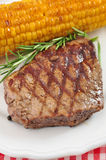Grilled steak with corn Stock Photos