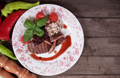 Grilled steak in cranberry sauce Royalty Free Stock Images
