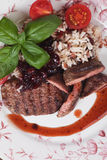 Grilled steak in cranberry sauce Royalty Free Stock Photos