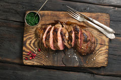Grilled Steak on cutting board with chimichurri sauce Stock Image