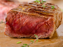 Grilled  steak on    cutting board . Royalty Free Stock Photos