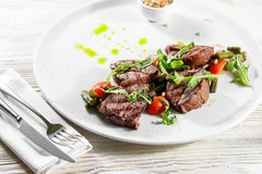 Grilled steak delicious beef meat on a white plate on a light background menu Royalty Free Stock Photos