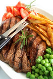 Grilled steak dinner Royalty Free Stock Images