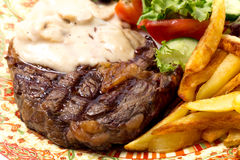 Grilled steak dinner closeup Royalty Free Stock Images