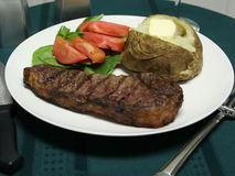 Grilled Steak dinner with utensils Royalty Free Stock Photo