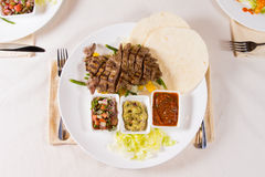 Grilled Steak Fajitas with Fixings on Plate Stock Photo