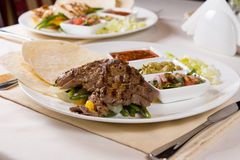 Grilled Steak Fajitas with Fixings on Plate Stock Photos