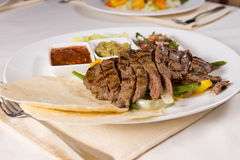 Grilled Steak Fajitas with Fixings on Plate Royalty Free Stock Images