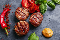 Grilled steak filet mignon wrapped bacon stock images