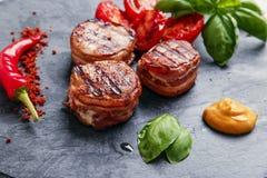 Grilled steak filet mignon wrapped bacon stock photo