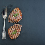 Grilled steak with fork Stock Photos