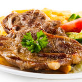 Grilled steak and French fries Royalty Free Stock Images