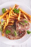 Grilled steak and french fries Stock Photography