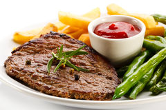 Grilled steak, French fries and green bean Royalty Free Stock Images