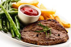 Grilled steak, French fries and green bean Royalty Free Stock Image