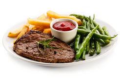 Grilled steak, French fries and green bean Royalty Free Stock Photos