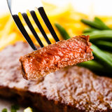 Grilled steak, French fries and green beans Royalty Free Stock Photography