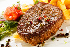 Grilled steak and French fries Royalty Free Stock Photos