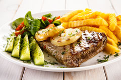 Grilled steak and French fries Stock Images