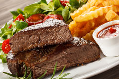 Grilled steak and French fries Royalty Free Stock Photo