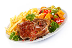 Grilled steak and French fries Stock Photos
