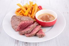 Grilled steak and french fries Stock Image