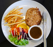 Grilled steak and French fries Royalty Free Stock Photography