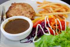 Grilled steak and French fries Stock Photo