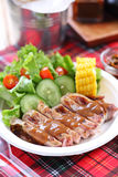 Grilled steak, French fries Stock Photos