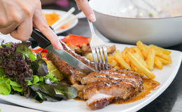 Grilled steak, French fries and vegetables Stock Photos