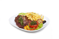 Grilled steak with french fries and vegetables on Stock Photos