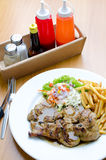 Grilled steak, French fries and vegetables Royalty Free Stock Photo