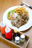 Grilled steak, French fries and vegetables Stock Photography