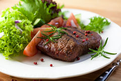 Grilled steak with fresh vegetables and herbs Royalty Free Stock Photo