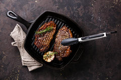Grilled Steak on frying Grill pan Stock Photos