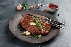 Grilled steak with garlic Stock Photo