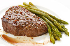 Grilled steak with Green asparagus Royalty Free Stock Photos