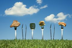 Grilling out barbecue concept against a blue sky Stock Photo