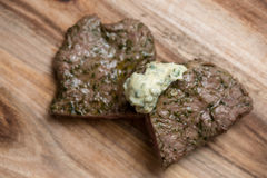 Grilled steak with herb butter. On wooden board Royalty Free Stock Image