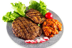 Grilled steak with lettuce Royalty Free Stock Photos