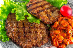 Grilled steak with lettuce Royalty Free Stock Image