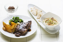 Grilled steak meal with hummus dip starter Stock Images