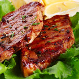 Grilled steak meat. Close up Stock Images