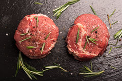 Grilled Steak Meat on the dark surface Stock Images
