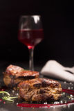 Grilled steak meat (mignon) on the dark surface. Dark background royalty free stock photography